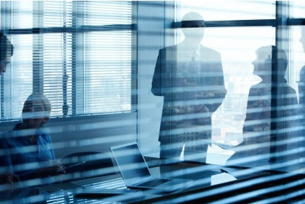 MAIN_207-Business-meeting-seen-through-windowblinds