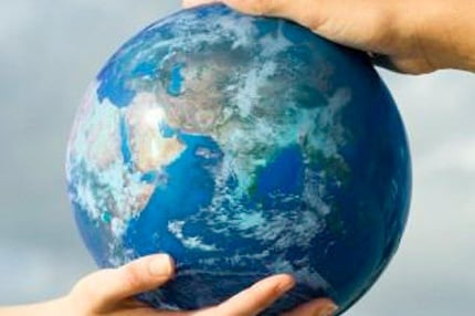 MAIN_219-Two-people-s-hands-supporting-globe-Earth_1