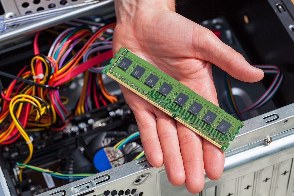 Hand with new ram data for computer