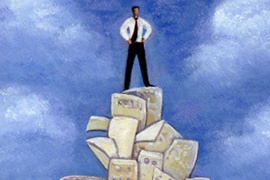 THUMB_93-man_atop_mountain_of_paper_1